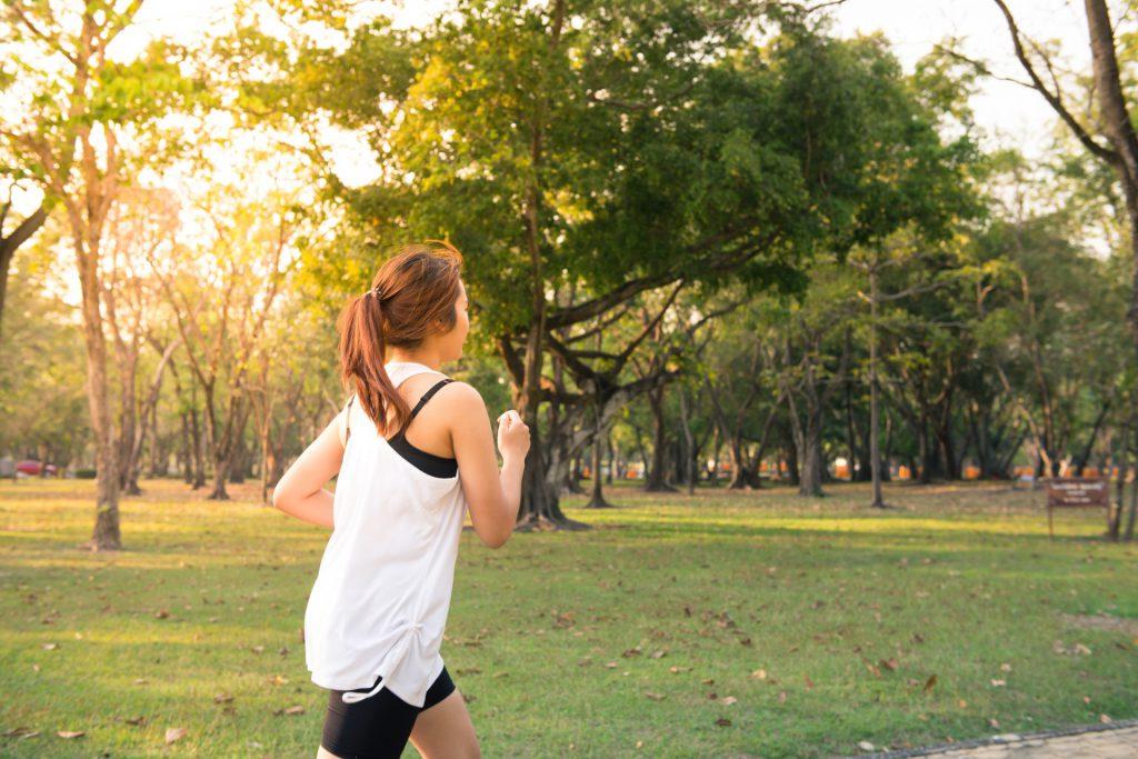 woman running at a park
